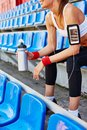 Girl with container of water modern in activewear spending time at stadium Stock Photo