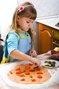 Girl cooking pizza Royalty Free Stock Photos