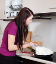 Girl cooking rice noodles in skillet Royalty Free Stock Photo