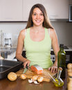 Girl cooking salmon fish Royalty Free Stock Photo