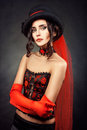 Girl in corset portrait of a a and gloves hat on his head Royalty Free Stock Photos