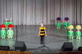 Girl in costumes performs on stage moscow apr of bee and girls of flowers district competition crystal droplet Royalty Free Stock Photos