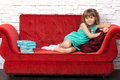 Girl on couch Stock Images