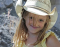 A Girl and a Cowboy Hat Royalty Free Stock Photos