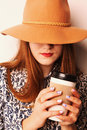 The girl cowboy in hat with coffee break invigorating drink Royalty Free Stock Photography