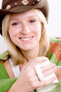 Girl in a cowboy hat with cup of tea Stock Photography