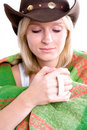 Girl in a cowboy hat with cup of tea Royalty Free Stock Images