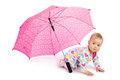 Girl crawls out of umbrella baby big pink Stock Image