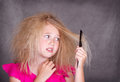 Girl with crazy tangled hair Royalty Free Stock Images
