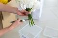 Girl creates a white bouquet Royalty Free Stock Photo