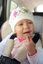 Girl crying in car toddler seat Stock Photos