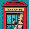 Girl crying in the red telephone booth retro Royalty Free Stock Photo