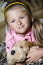 Girl with cuddly toy Stock Images