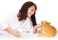 Girl with a cup of coffee and her cat in bed Royalty Free Stock Photos