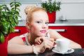 Girl with cup of morning coffee in interior of kit Royalty Free Stock Photo