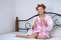 Girl in curlers on the bed morning Stock Photos