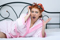Girl in curlers on the bed morning Royalty Free Stock Photography