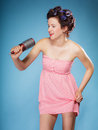 Girl with curlers in hair holds hairbrush Royalty Free Stock Photo