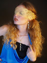 Girl with curly hair shows jewelry blindfold Royalty Free Stock Images
