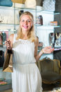 Girl customer in bijouterie shop Royalty Free Stock Photo