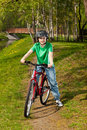 Girl cycling Stock Images
