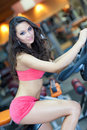 Girl  is cycling in fitness hall Royalty Free Stock Image