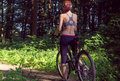 Girl cyclist on a mountain bike in a forest Royalty Free Stock Photo