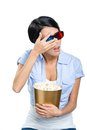 Girl in d glasses watching film through the hands with bowl full of popcorn isolated on white Royalty Free Stock Image