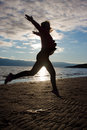 Girl dancing on beach at sunset Royalty Free Stock Photo