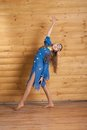 Girl dancing in blue dress Stock Image