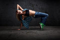 Girl dancing hip hop grunge concrete wall background Royalty Free Stock Photos