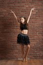 Girl dancing near brick wall Royalty Free Stock Photo