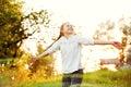 Girl dancing in the sunlight Stock Photo