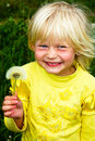 Girl and dandelion Stock Photos