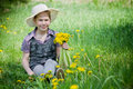 Girl dandelions in countryside with Royalty Free Stock Image