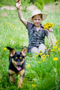Girl dandelions in countryside with and dog Royalty Free Stock Images