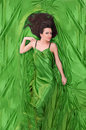 Girl with dark hair lying on green Royalty Free Stock Photo