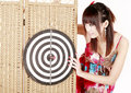 Girl with dartboard Royalty Free Stock Image
