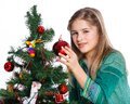 Girl decorating christmas tree theme beautiful isolated on white backround Royalty Free Stock Photos