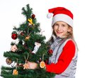 Girl decorating christmas tree theme beautiful isolated on white backround Stock Images