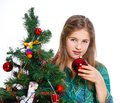 Girl decorating christmas tree theme beautiful isolated on white backround Royalty Free Stock Photo