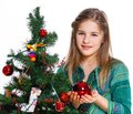 Girl decorating christmas tree theme beautiful isolated on white backround Stock Image