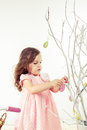 Girl decoration spring branches with easter eggs Royalty Free Stock Image