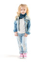 Girl in denim suit looked down little Stock Image