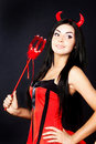 Girl devil holds the magic wand