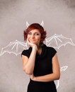 Girl with devil horns young nasty and wings drawing Royalty Free Stock Photography
