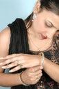 Girl with diamond bracelet Stock Images