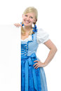 Girl in dirndl with ad space young woman traditional bavarian tracht holds and smile Stock Photo
