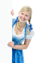 Girl in dirndl with ad space young woman traditional bavarian tracht holds and smile Royalty Free Stock Photos