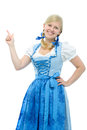 Girl in dirndl points her finger upwards happy smiling bavarian Stock Images